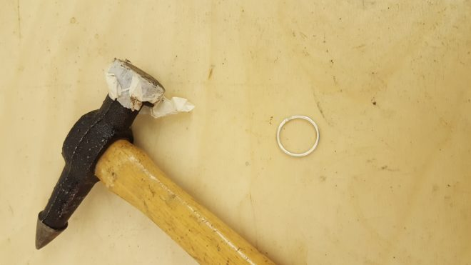 hammering our rings into shape, adding texture with a hammer