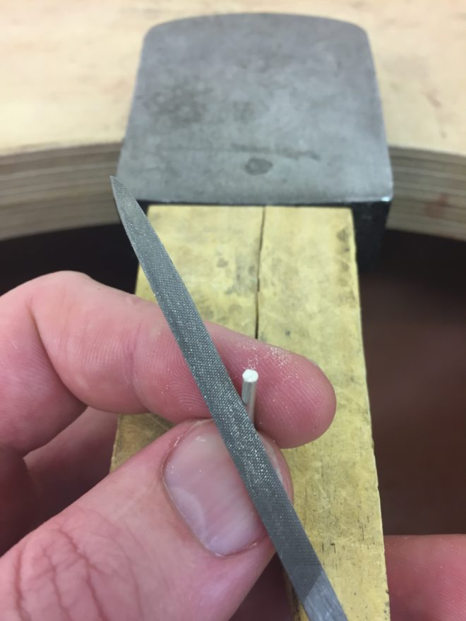 filing down the metal wire