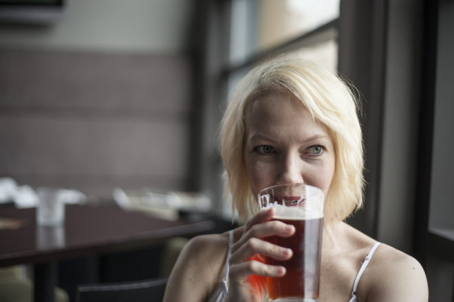 woman drinking ale