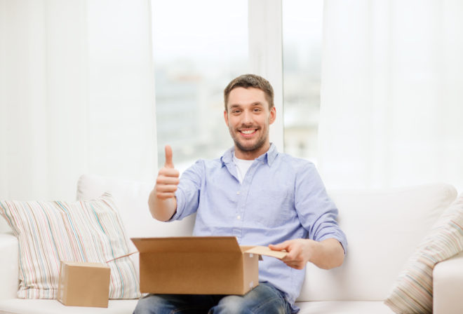 man opening parcel