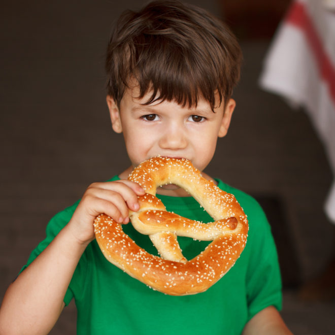 child eating pretzel