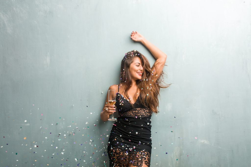 Woman with a glass of champagne while in self-isolation