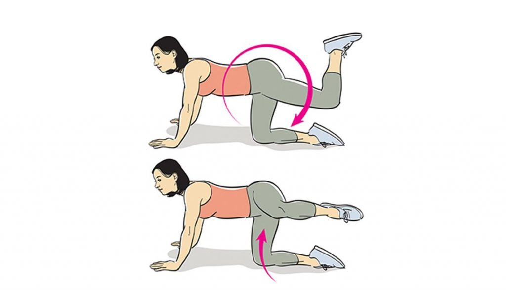 woman doing kneeling hip circles for at home workout