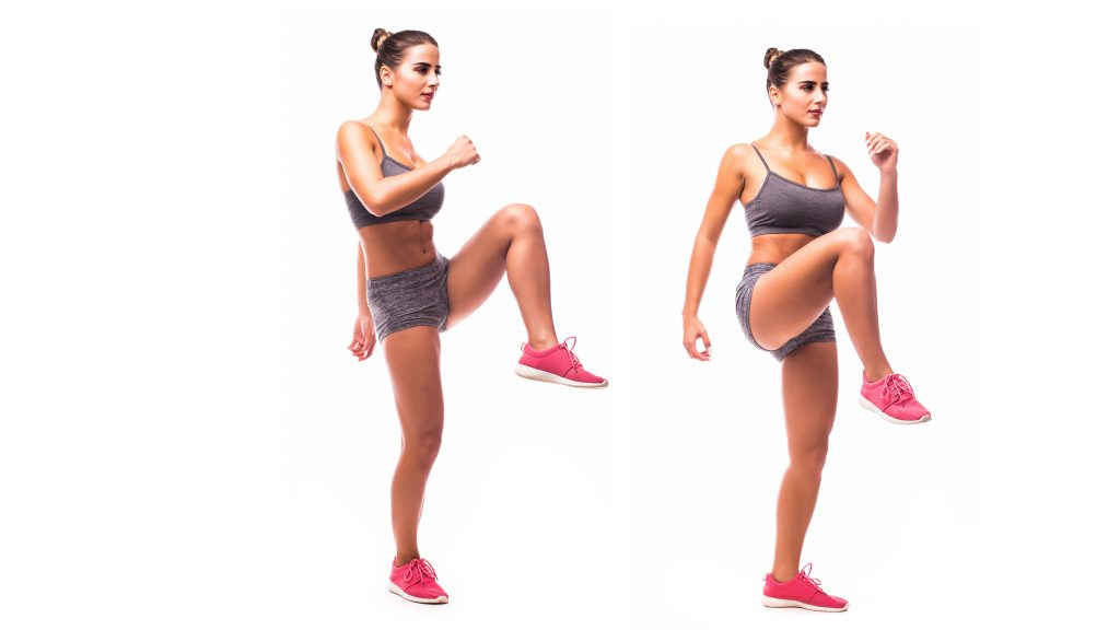 woman doing high knees for at home workout