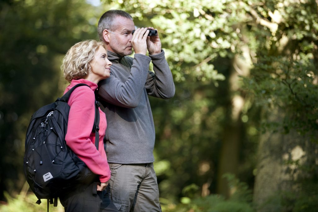 A couple out birdwatching after reading our complete guide
